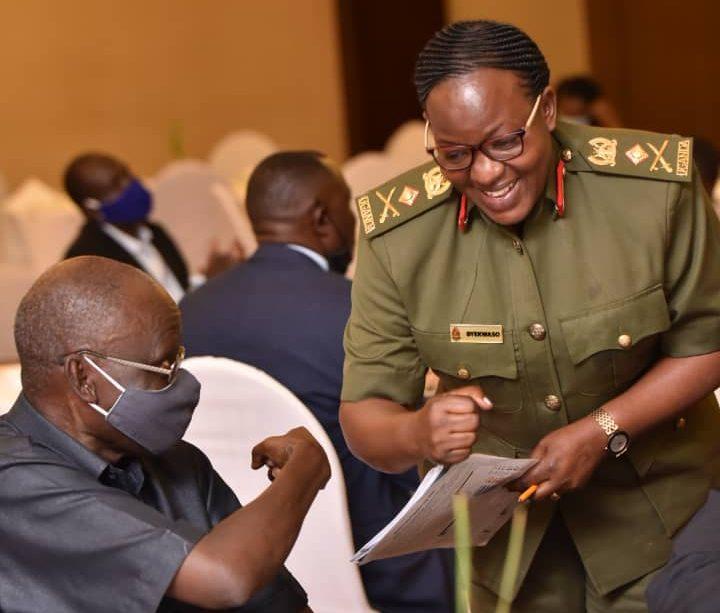 Prof Fredrick Jjuko greets UPDF Spokesperson, Brig. Flavia Byekwaso/ Photo: Uganda Editors' Guild