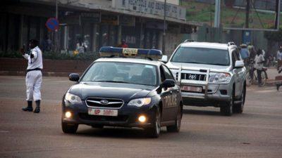 A Police lead car escorting a Ugandan Government Official's motorcade/convoy